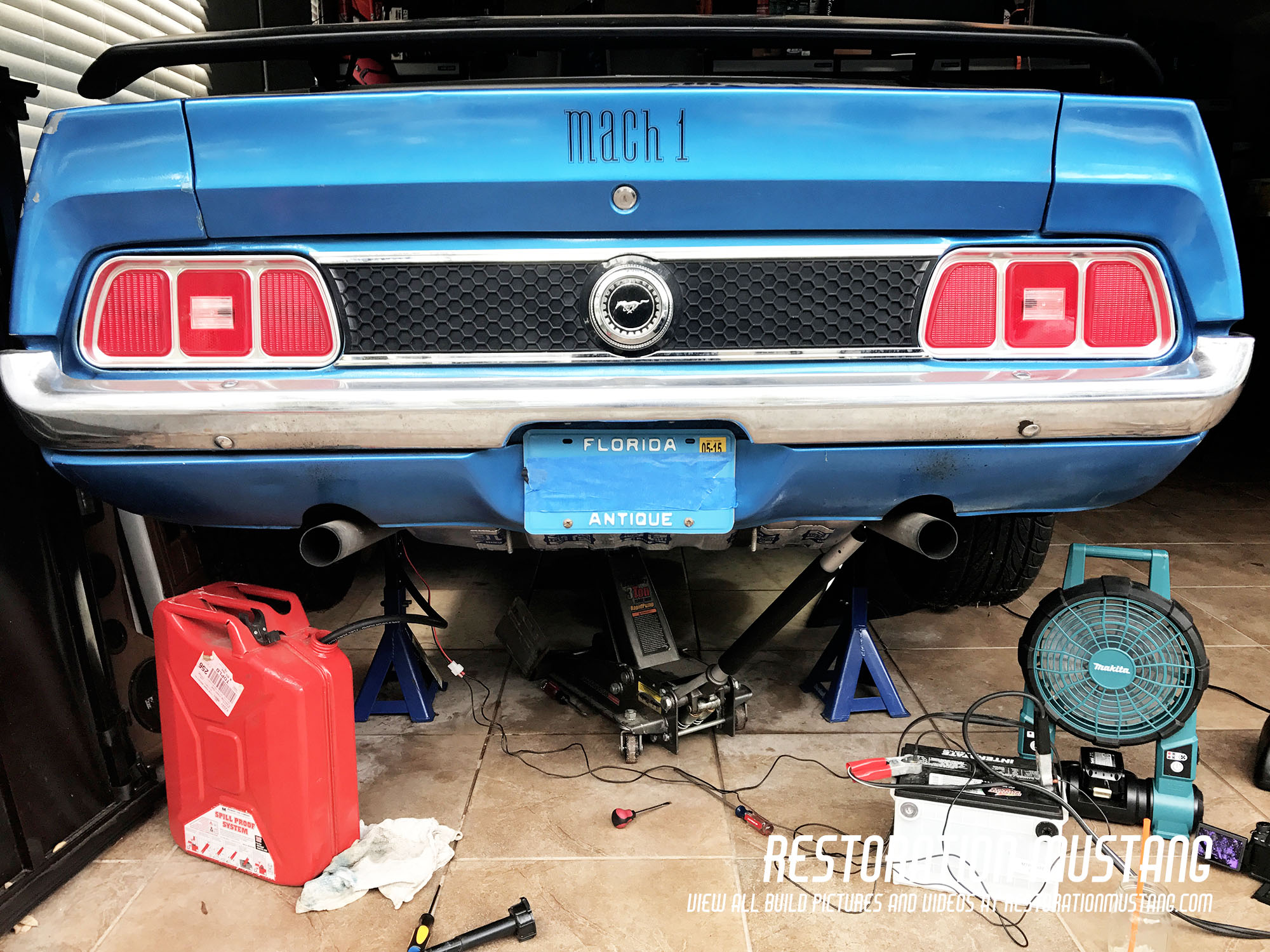 showing the back of the mustang prior to removal of the gas tank  fuel pump